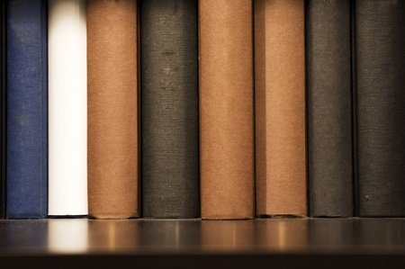 a close up shot of book on shelf, indoor setting. Stock Photo - 11753271