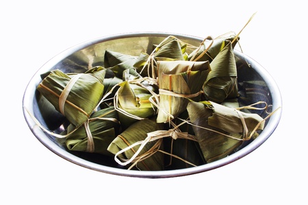 chinese style rice dumplings in a big bowl, isolated on white. For dragon boat festival. photo