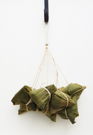 a bundle of chinese rice dumplings, a traditional food for dragon boat festival.