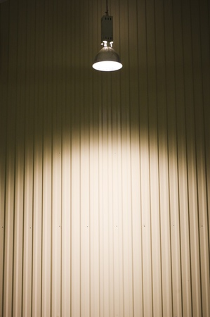 attentions: empty warehouse with a ceiling light.  Stock Photo