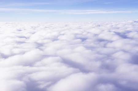 fluffy clouds: Photo of clouds taken from above  Stock Photo