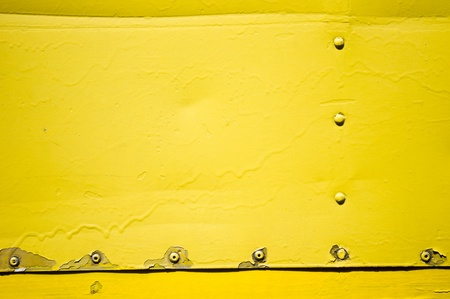 yellow metal plate with rivet, for grunge or abstract background. photo