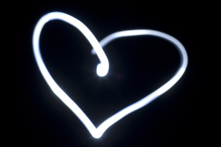 darkness: heart shape, light painting in the darkness.