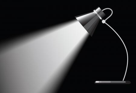 bureaulamp met een zwarte achtergrond, met een lege ruimte onder schijnwerpers.