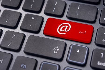 computer message: at sign or ampersat on keyboard enter key, for email concepts