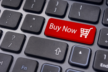 e commerce: Buy now concepts, with message on computer keyboard