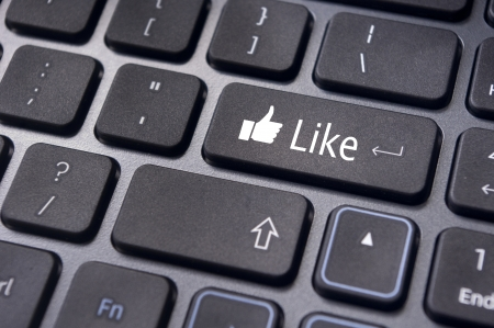 A like message on enter keyboard for social media concepts. photo