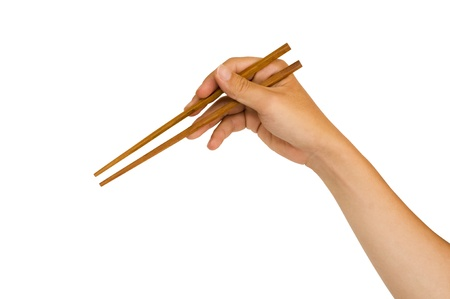 chopstick: isolated man hand holding wooden chopstick