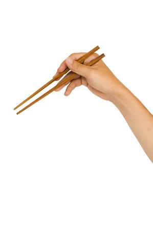 chopstick: isolated man hand holding wooden chopstick