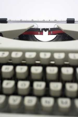 a close up of typewriter, focus on paper page  photo