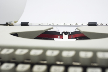 a close up of typewriter, focus on paper where message will be typed  photo