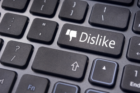 A dislike message on enter keyboard for anti social media concepts. Stock Photo - 17778206