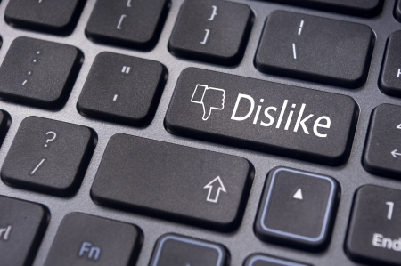 anti social: A dislike message on enter keyboard for anti social media concepts. Stock Photo