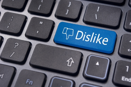 discourage: A dislike message on enter keyboard for anti social media concepts. Stock Photo
