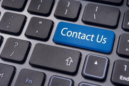 contact us message on keyboard, for online communication concept  photo