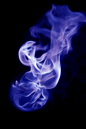 dynamic heat black: bluish fire with a black background, abstract background. Stock Photo