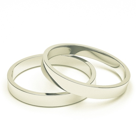 silver wedding anniversary: A pair of isolated silver or platinum weddings rings.