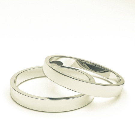silver ring: A pair of isolated silver or platinum weddings rings.