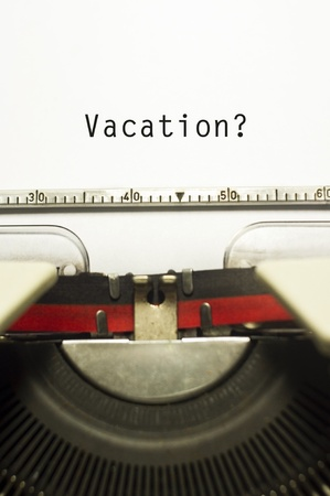 concepts of vacations from work, with message on typewriter. Stockfoto