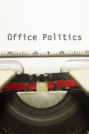 office politics: office politics, message on typewriter for conceptual background.