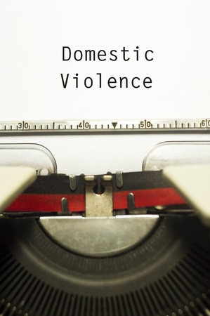 domestic violence concept, with message on typewriter paper. photo