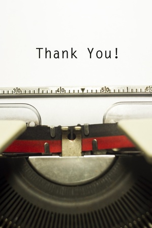 vintage typewriter: thank you message on typewriter paper, for appreciation concepts. Stock Photo