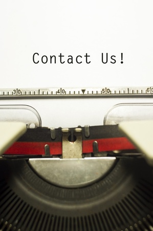 write us: contact us concepts, with message on typewriter paper. Stock Photo