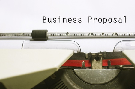proposal: concept of business proposal, with message on typewriter. Stock Photo