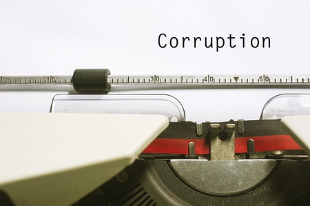 government regulations: corruption concepts, with message on typewriter paper.