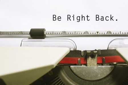 absence: be right back concepts, with message on typewriter. For website maintenance message.