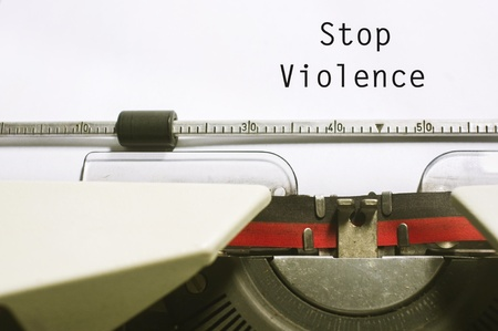 social issues: stop violence concept, with message on typewriter paper.