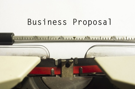 proposals: concept of business proposal, with message on typewriter. Stock Photo