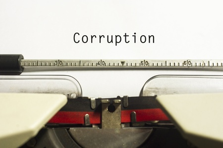 corporate greed: corruption concepts, with message on typewriter paper.
