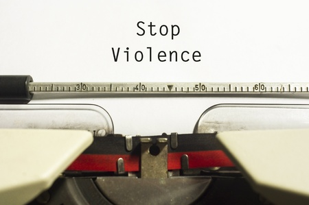 stop violence concept, with message on typewriter paper. photo