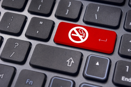 quit: a no smoking sign on keyboard enter key, to convey anti smoking concepts in workplaces or offices.