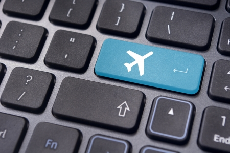 a plane sign on keyboard, to illustrate online booking or purchase of plane ticket or business travel concepts.