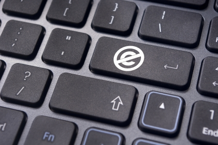 copyrights: a no copyright or public domain mark on keyboard to illustrate the concepts.