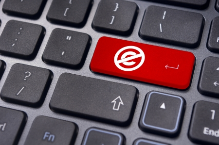 copyrighted: a no copyright or public domain mark on keyboard to illustrate the concepts.