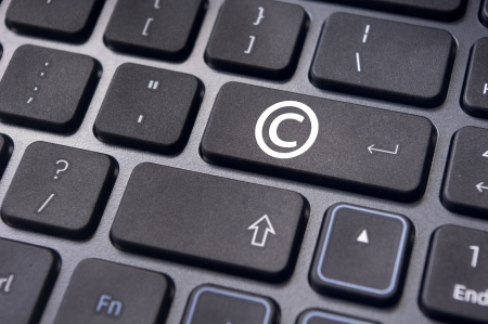 a copyright symbol on keyboard to illustrate the concepts. photo