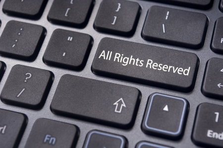 patents: an All Rights Reserved message on keyboard to illustrate the concepts.