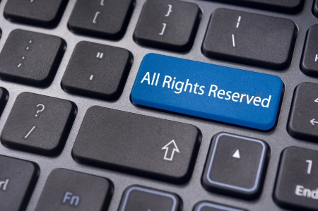 an All Rights Reserved message on keyboard to illustrate the concepts. photo