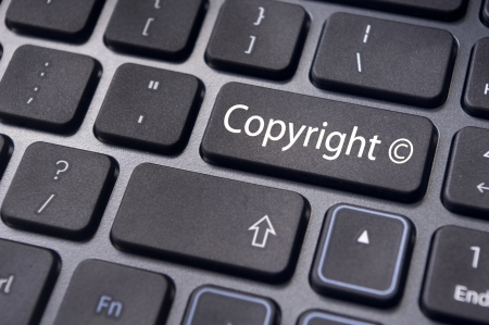 copyrights: message on keyboard enter key, to illustrate the concepts of copyright. Stock Photo