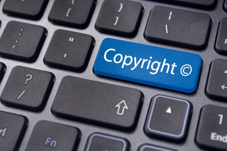 message on keyboard enter key, to illustrate the concepts of copyright. Stockfoto