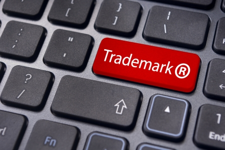message on keyboard enter key, to illustrate the concepts of trademark. photo