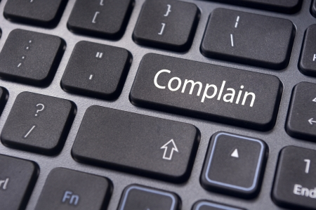 complain: to illustrate poor customer service, with complain message on keyboard.