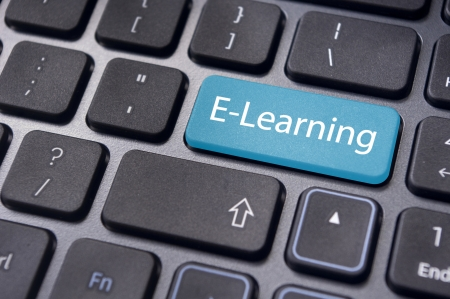 Concepts of E-learning, for computer based learning, with a message on enter key of keyboard. photo