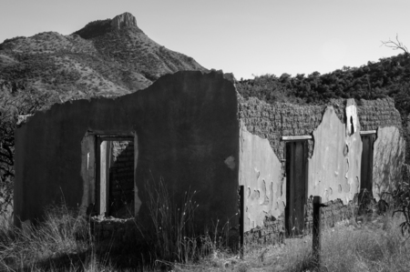 Crumbling old adobe building and Montana Peak, Ruby, Arizona