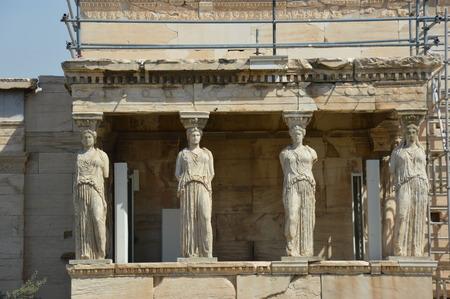 acropolis: Kariatides of Acropolis center view Stock Photo