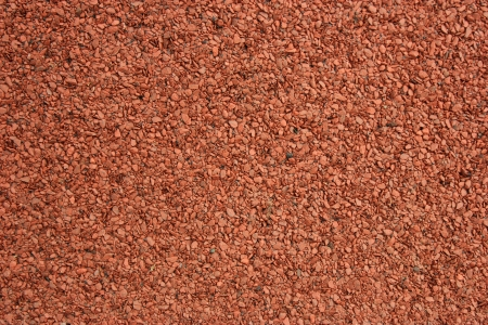 asphalt shingles: A macro of the stones of a red asphalt shingle Stock Photo
