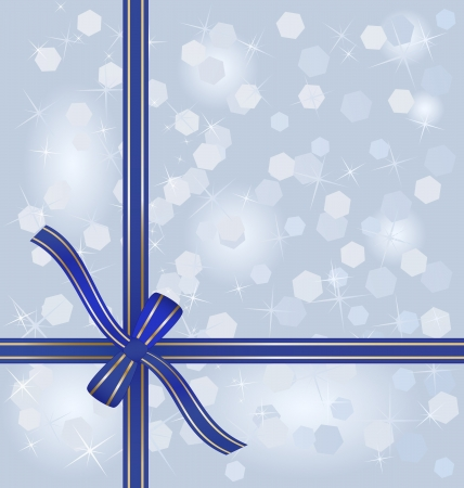 wrapped around: blue gift ribbon wrapped around blurred winter background
